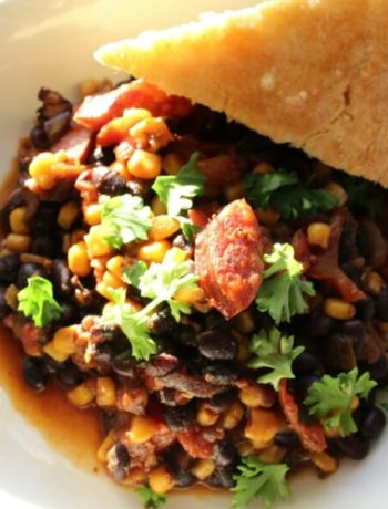 An easy and delicious one pan meal, this smoked sausage skillet is made with black beans, corn, and tomatoes for a hearty and filling dinner.