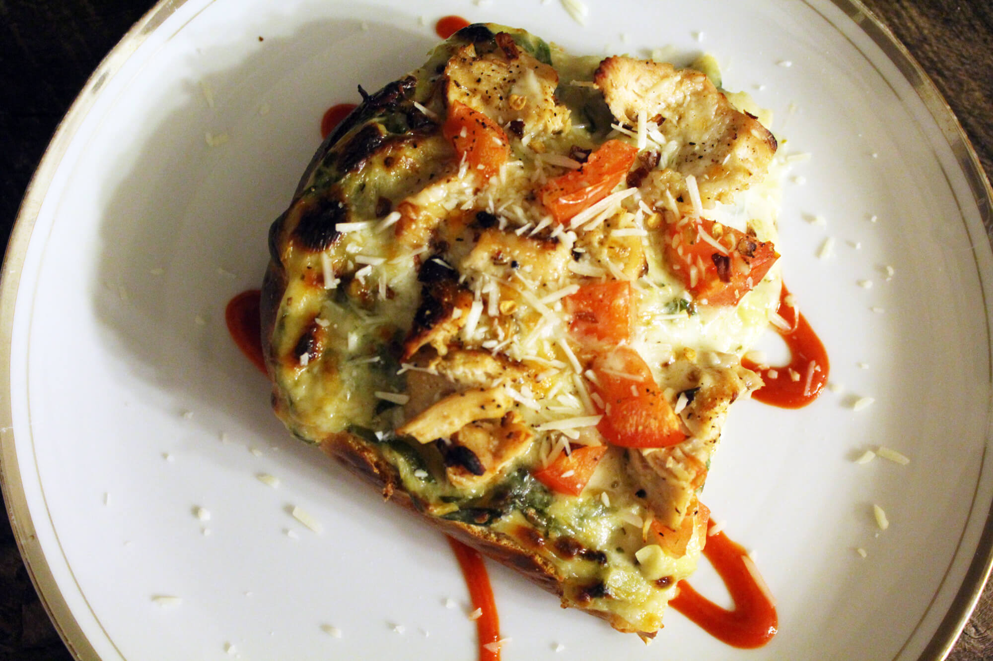 If you love spinach artichoke dip, and you love pizza, why not combine the two? This cheesy pizza bread recipe features fresh spinach, artichokes & chicken.