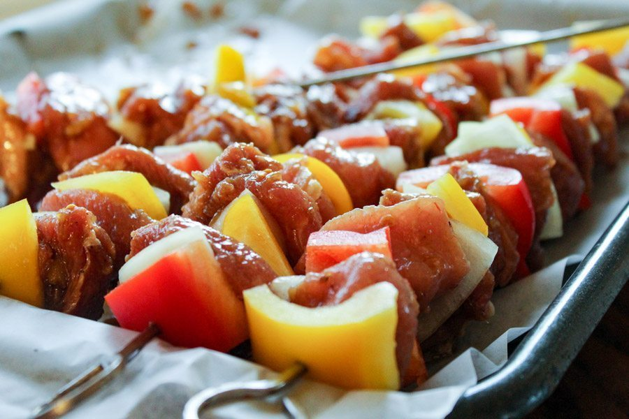 Hawaiian Grilled Pork Kabobs are marinated crushed pineapples and soy, then grilled to perfection with colorful veggies.