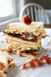 Gosh Almighty Pimento Cheese BLT's | Ole Miss Tailgate Savory pimento cheese on toasted bread, topped with fresh lettuce, sliced red tomato, and crisp bacon. Talk about a game winning recipe!