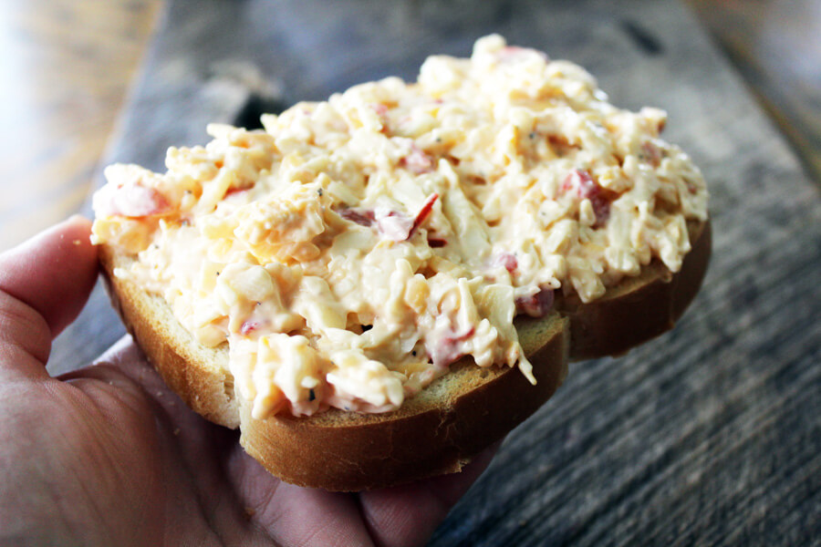 a piece of country white bread with a generous amount of pimento cheese spread