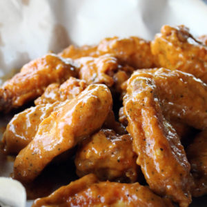 Cocky's Carolina Mustard Wings just might be the best fried chicken wings I have ever eaten.And I've eaten a lot of chicken wings. Perfectly crispy breading, not greasy. And once you toss them in our one of a kind Carolina Mustard sauce ...WOW. These will certainly be the crave-worthy item that everyone will be raving about.