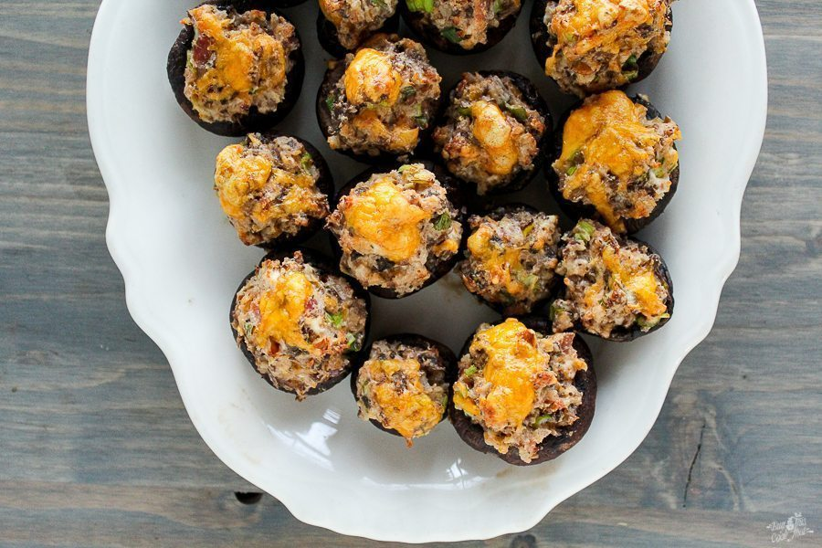 Our Stuffed Mushroom appetizer recipe will make you a Kitchen Rock Star. Cream cheese, cheddar, bacon and pecans make this THE recipe of the holiday season.