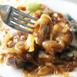 Ladies love pork chops. But Smothered Onion Pork Chops is a dinner recipe you can keep in your back pocket when you need to feed a hungry man. Tender and tasty baked pork chops with an easy homemade onion gravy.