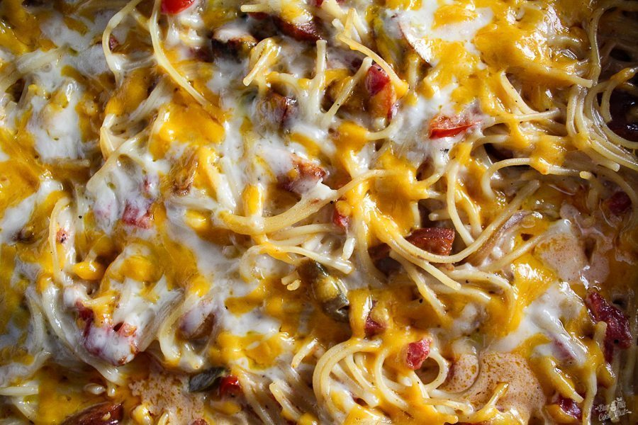 Spicy Cajun Pasta with Cajun sausage, colorful bell peppers and sweet onions. Combined with creamy Casserole magic and of course...Cheddar and Jack cheese!