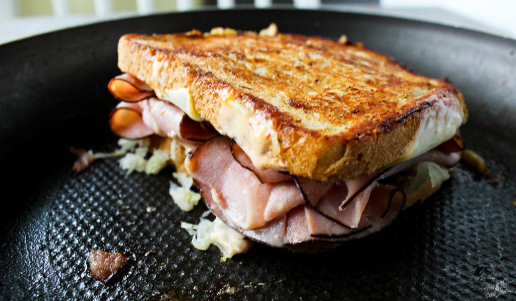 A Killer Ham Reuben Sandwich. Layers of deli-sliced black forest ham on New York rye. With Muenster cheese, sauerkraut and Russian Horseradish Sauce. Money.