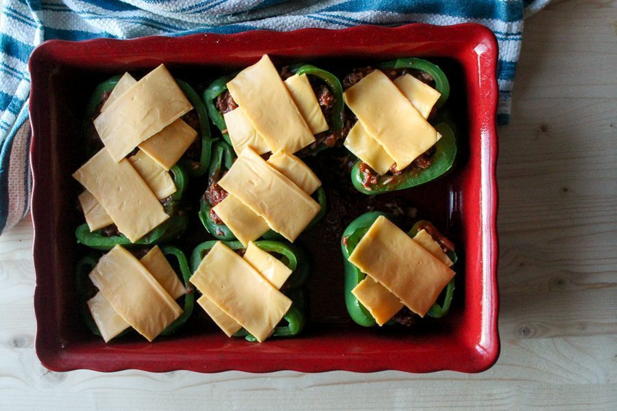 Sweet and tangy Sloppy Joes stuffed in sweet bell peppers and topped with cheese. This easy stuffed peppers recipe will be a family hit!