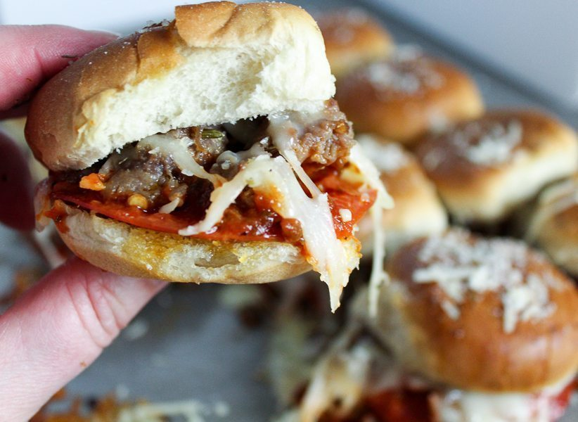 Easy Pizza Sliders are loaded with delicious ingredients and fast to make, bake and take to your next party. Make them your own with your favorite toppings.