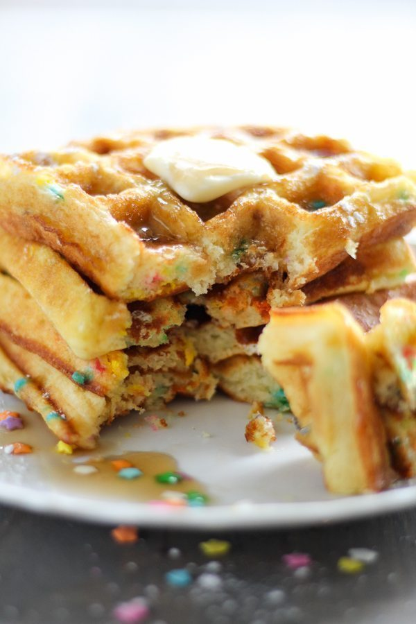 A white plate with cake waffles