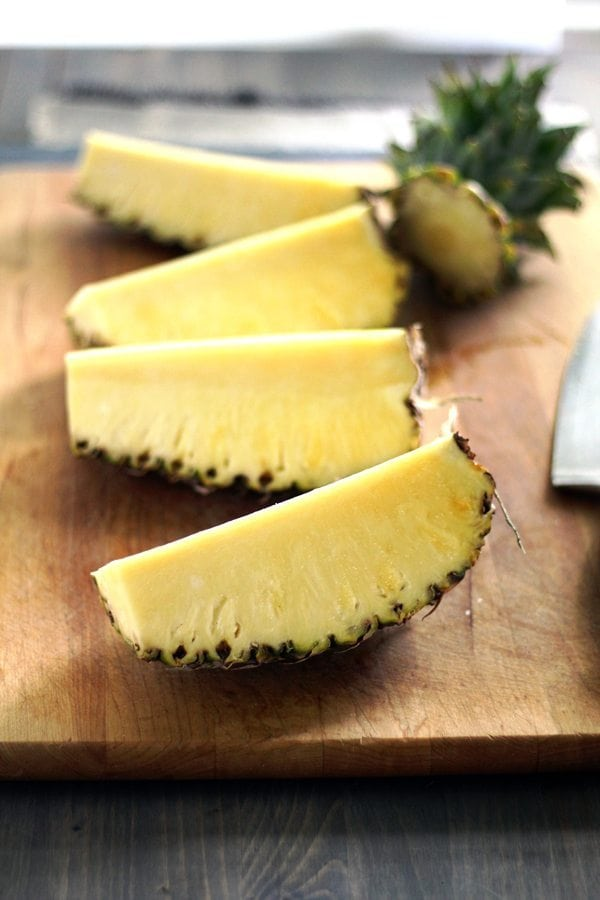 Fresh chopped pineapple on a cutting board