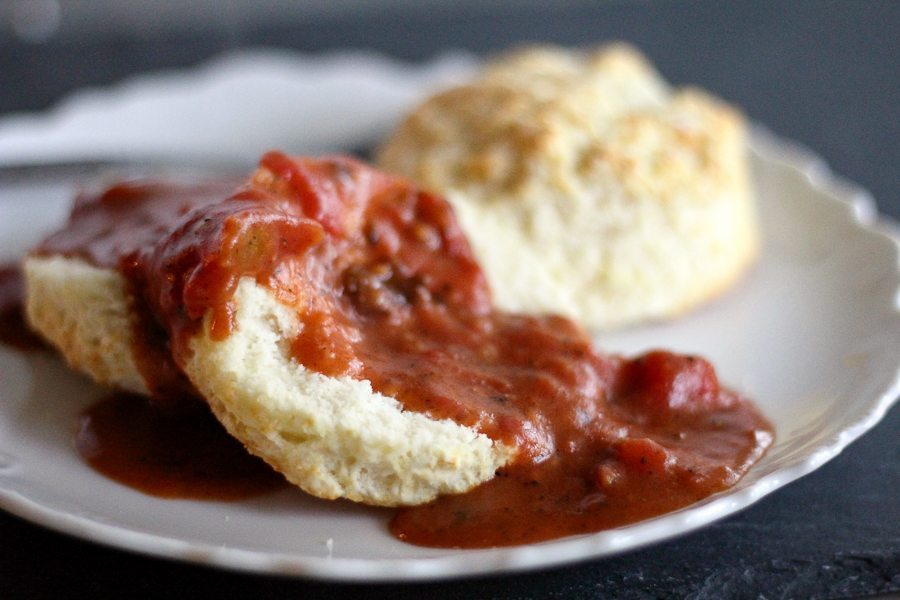 A plate of hot biscuits smothered in a rich tomato gravy