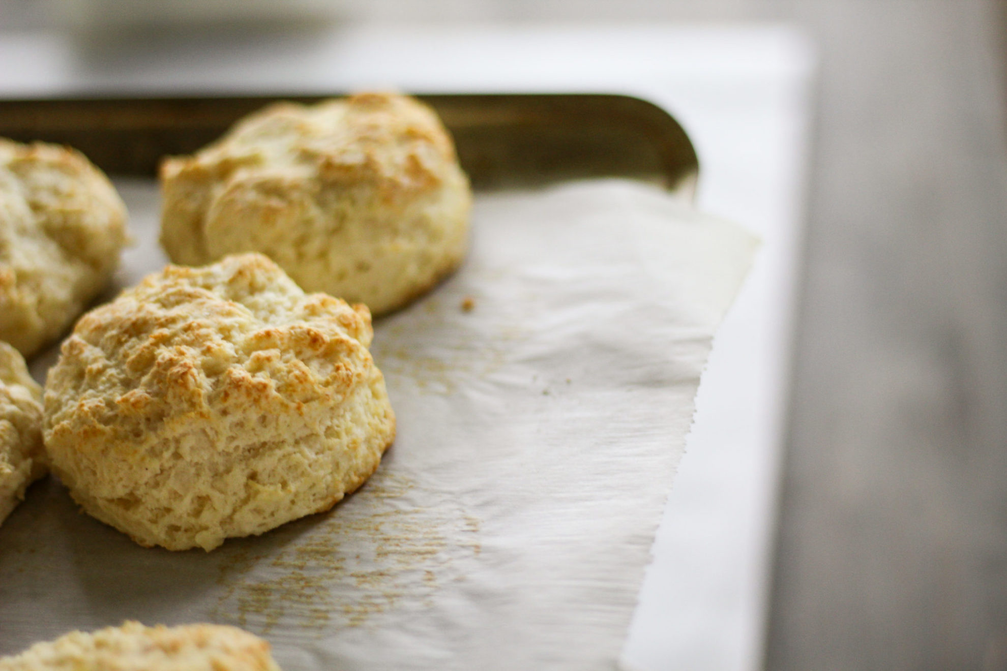 a pan of golden homemade biscuits