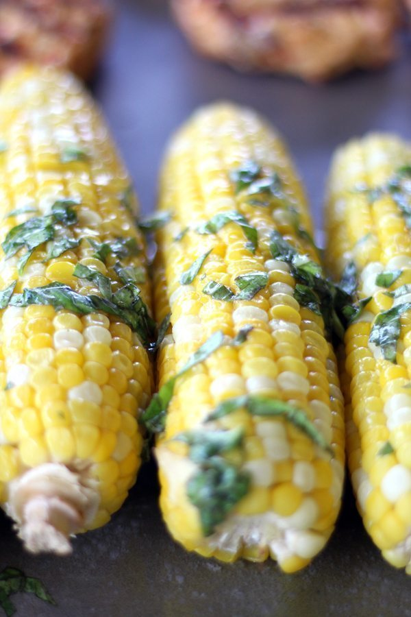 A wonderfully delicious way to prepare fresh sweet corn. Fragrant basil and salted butter poured over grilled corn. Simply amazing.