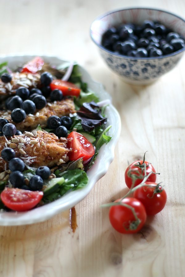Fried chicken salad loaded with fresh blueberries, ripe tomatoes, sunflower seeds, mixed greens. All benefits of a fit salad plus buttermilk fried chicken.