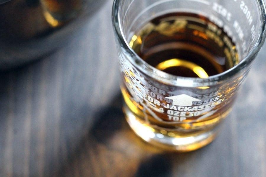 A shot glass of bourbon