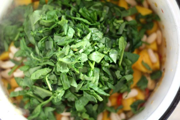 Fresh chopped spinach is added to our pot of butternut squash soup