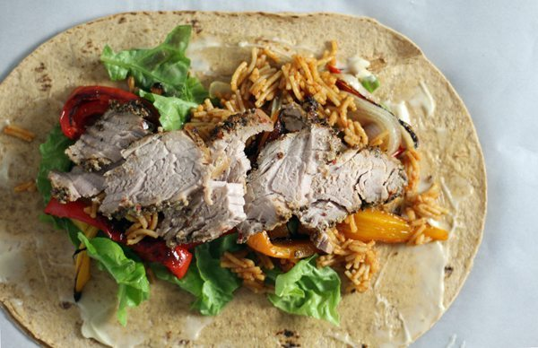 Pork, vegetables and rice on a sandwich wrap