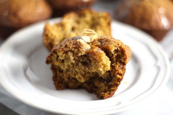 A plate with a warm pumpkin muffin with butter