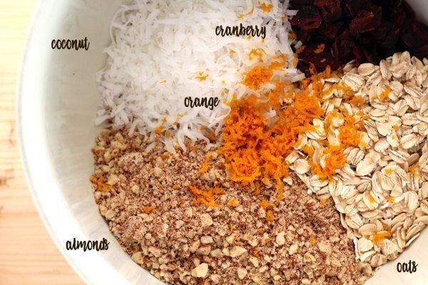 A bowl of almonds, oats, orange zest, coconut and cranberries
