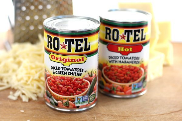RO*TEL Diced tomatoes next to shredded cheese