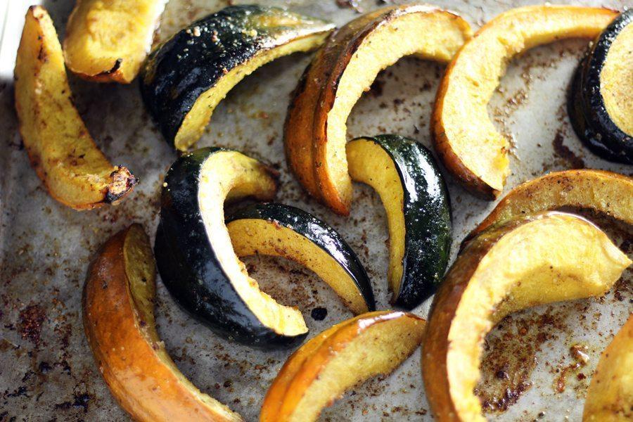 Acorn squash wedges roasted on a baking sheet