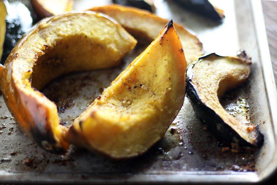 Acorn squash roasted on a baking sheet