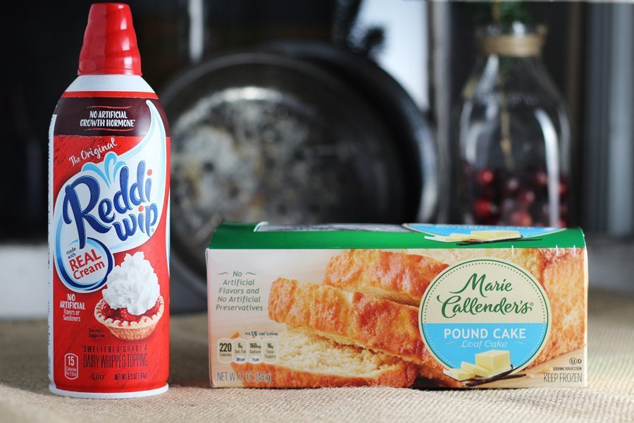 A can of whipped cream next to a pound cake