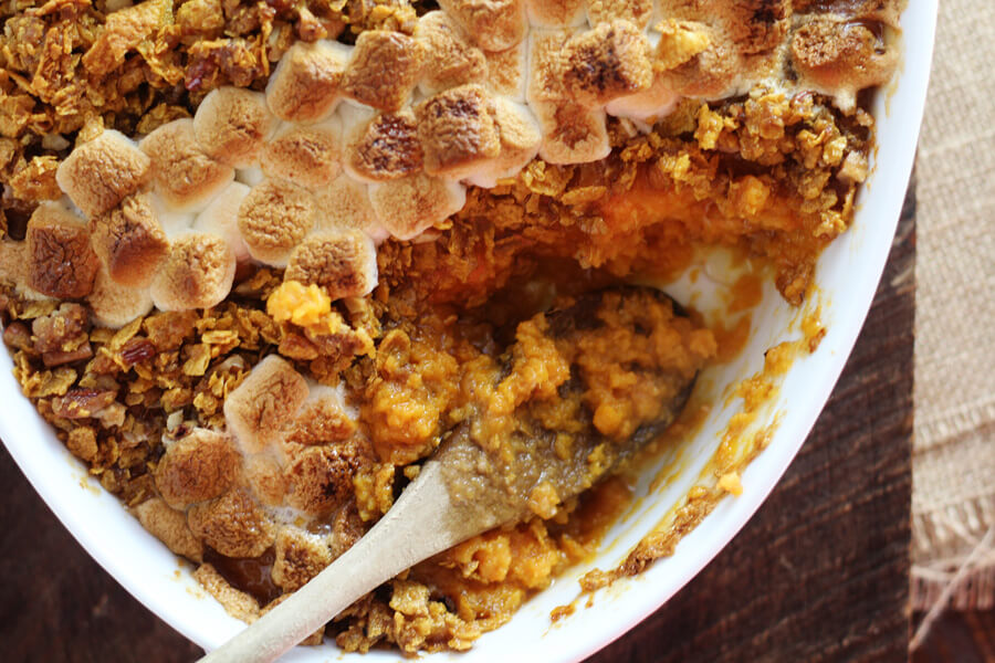 Toasted marshmallows and pecan crumble on top of sweet potato casserole