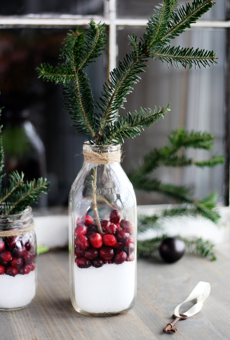 Use jars, milk bottles, or any container you'd like for this rustic Christmas decor idea.