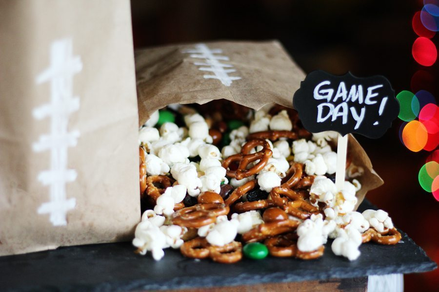 A bag of snack mix with popcorn, pretzels, chocolate candy and more