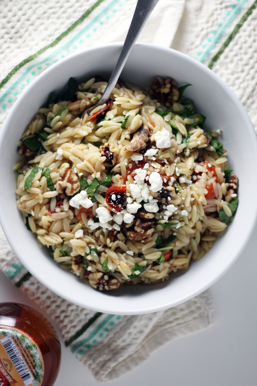 Orzo pasta tossed with roasted tomatoes, herbs and walnuts.