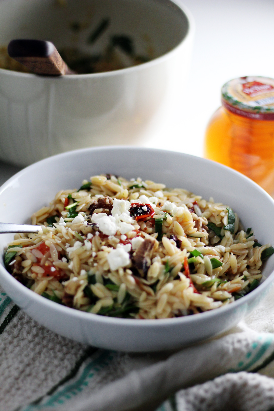 Orzo pasta tossed in a light honey-lemon dressing and roasted tomatoes