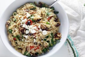 Orzo pasta tossed in a tangy lemon-honey dressing, fire roasted tomatoes, feta, and spinach.