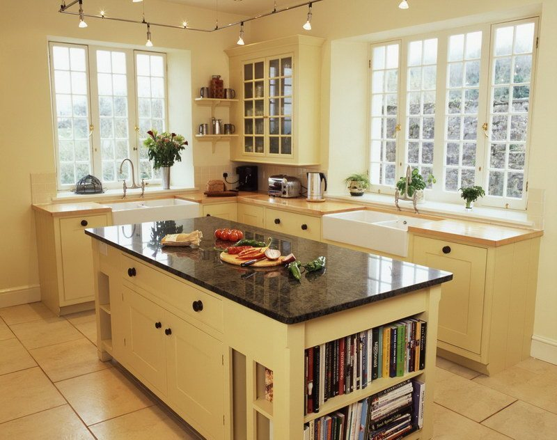 French country kitchen islands, classic style with bookshelves, storage and lovely countertop.