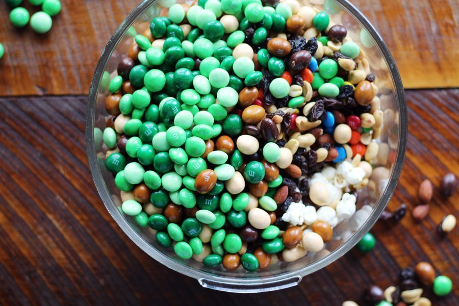 Your favorite chocolate candy + pretzels + popcorn and trail mix makes the best party mix ever.