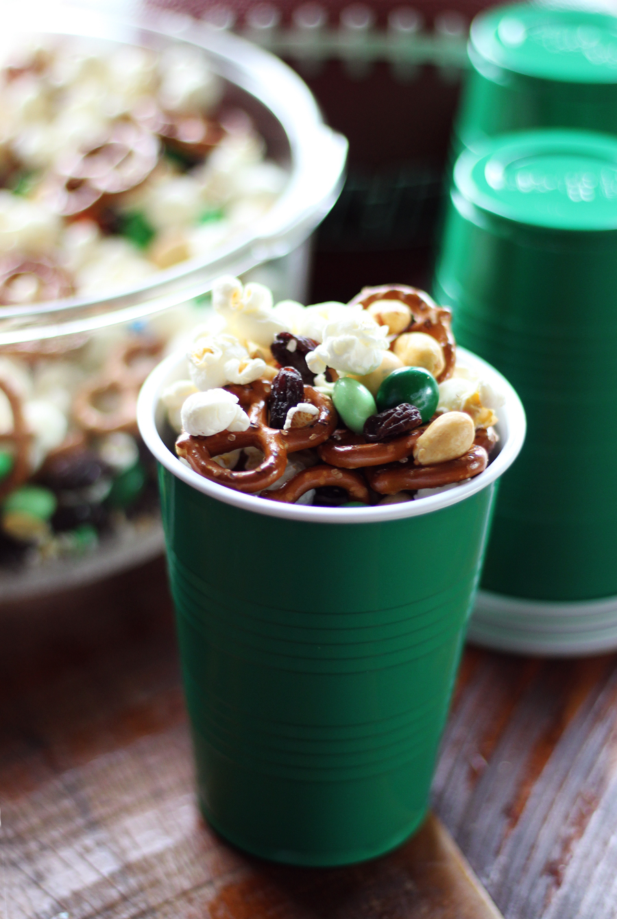 Pick team colors or stick with the basic green and brown to customize your gameday party mix.