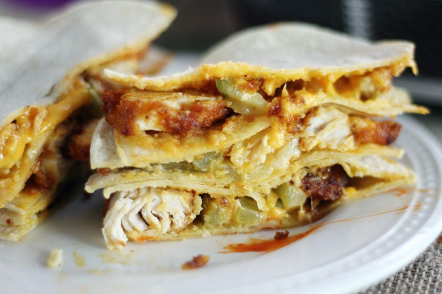 Tangy + spicy chicken with a little sweet heat, sliced and served with melty cheese in quesadilla form. WIN!