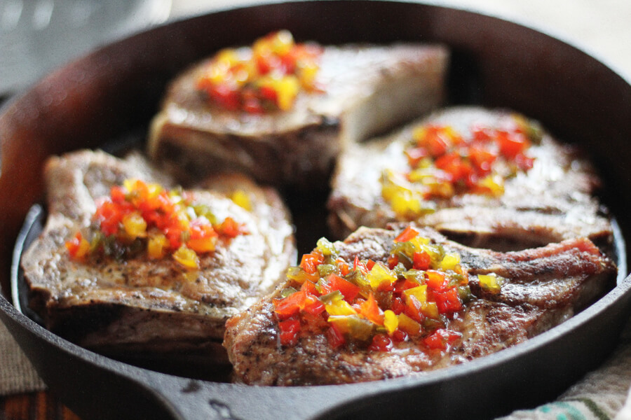 Jalapenos and sweet bell peppers are simmered until thick with cider vinegar and sugar, then spooned over our moist and tender skillet pork chops.