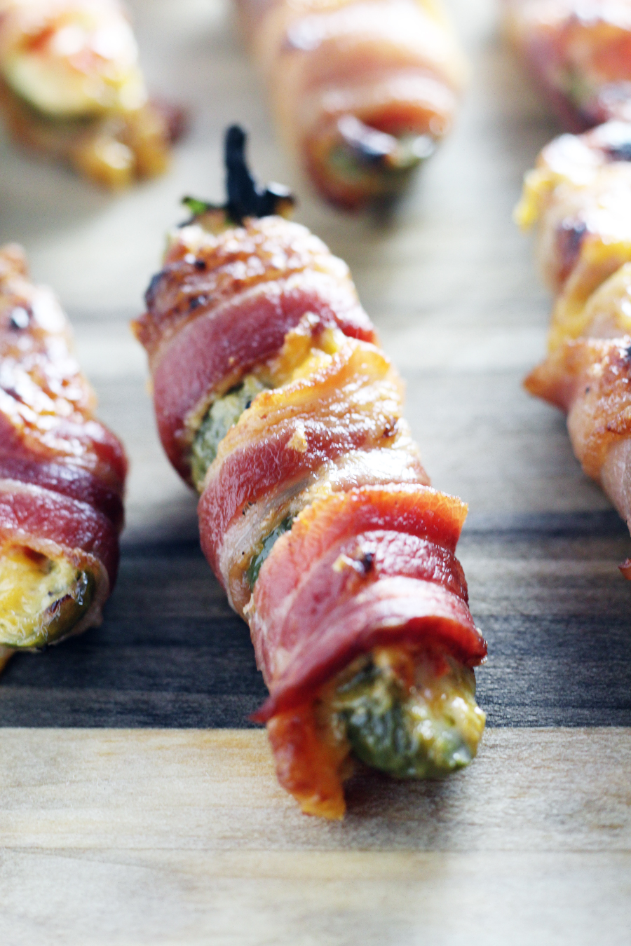 A jalapeno pepper stuffed with pimento cheese and wrapped in bacon