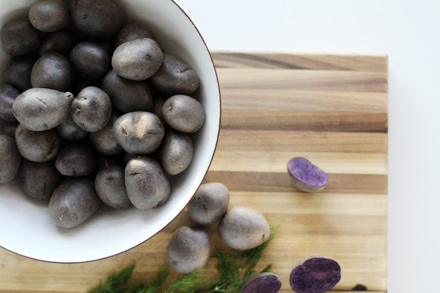 This recipe for purple potato salad starts with simple roasted potatoes.