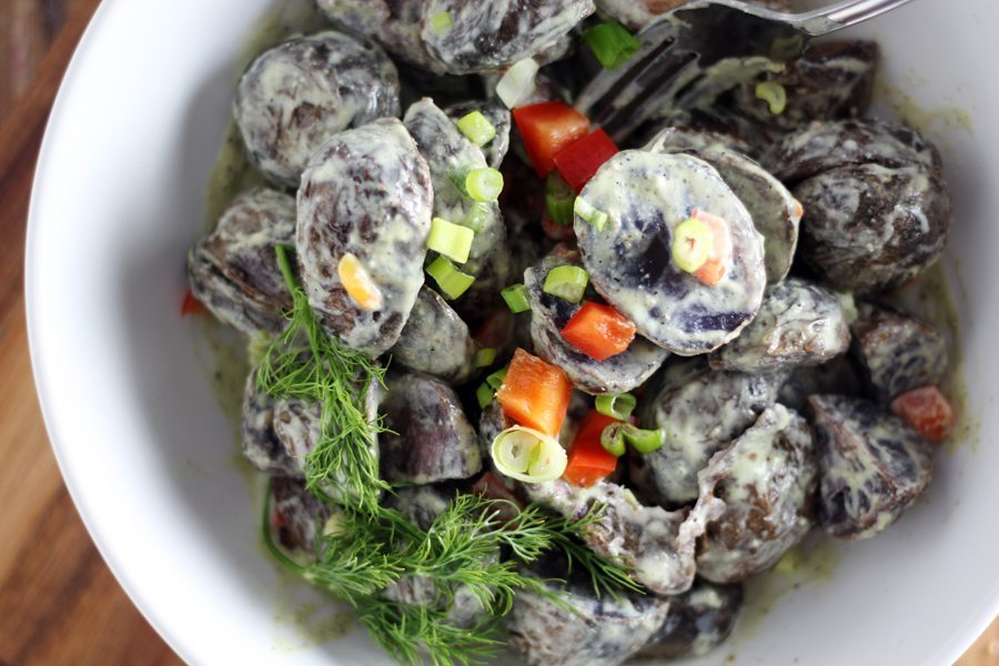 Roasted purple potatoes tossed in a creamy dressing