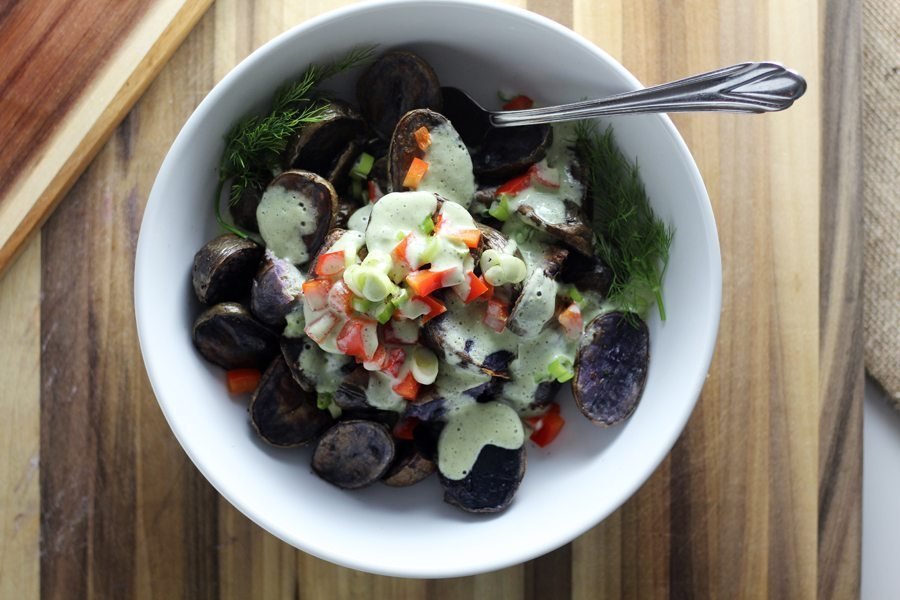 Serve the purple potato salad warm. I like to let everyone assemble their own serving so they can control how much dressing they want.