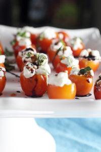Tomato Basil Caprese Bites on a white serving platter.