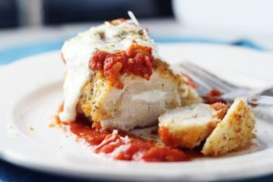 Topped with marinara and melted fresh mozzarella, this baked chicken parmesan is a wonderful dinner recipe.