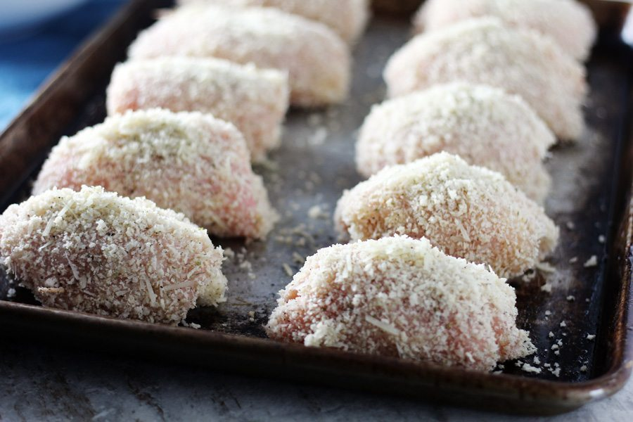 Get ready! These breaded chicken pieces are about to hit the oven and become a delicious meal of Baked Chicken Parmesan.