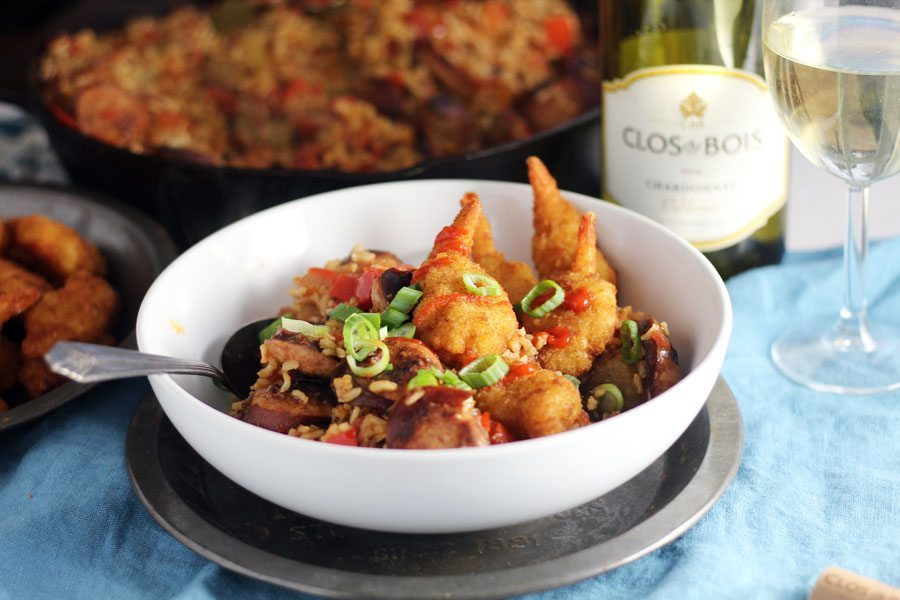 Creole shrimp jambalaya bowls buy this cook that a bowl of shrimp jambalaya next to a glass of chardonnay with a skillet in the forumfinder Choice Image