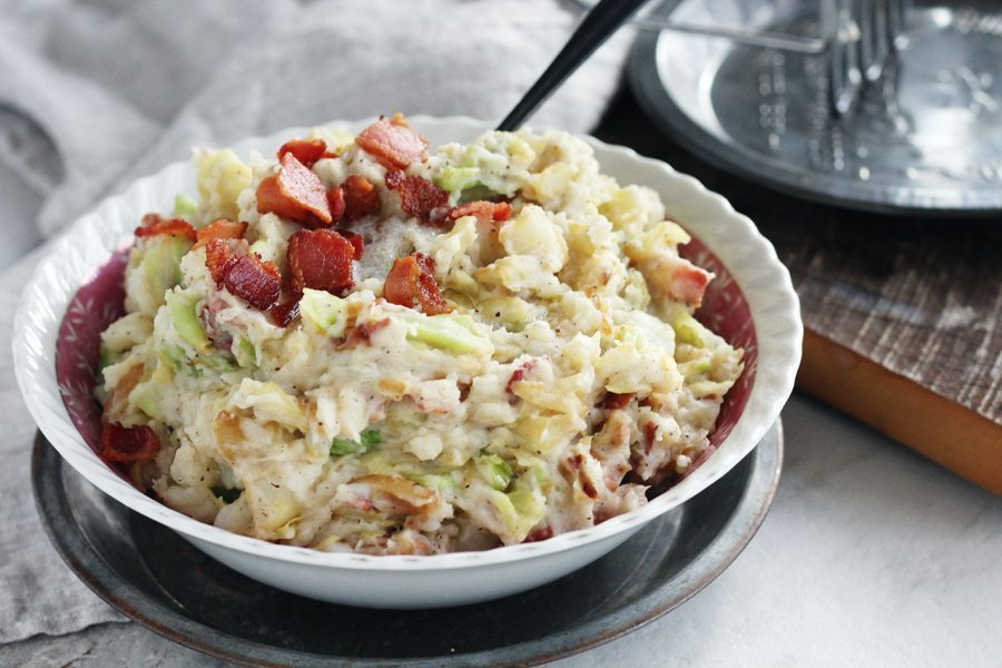 A vintage bowl of Irish Colcannon topped with crispy bacon