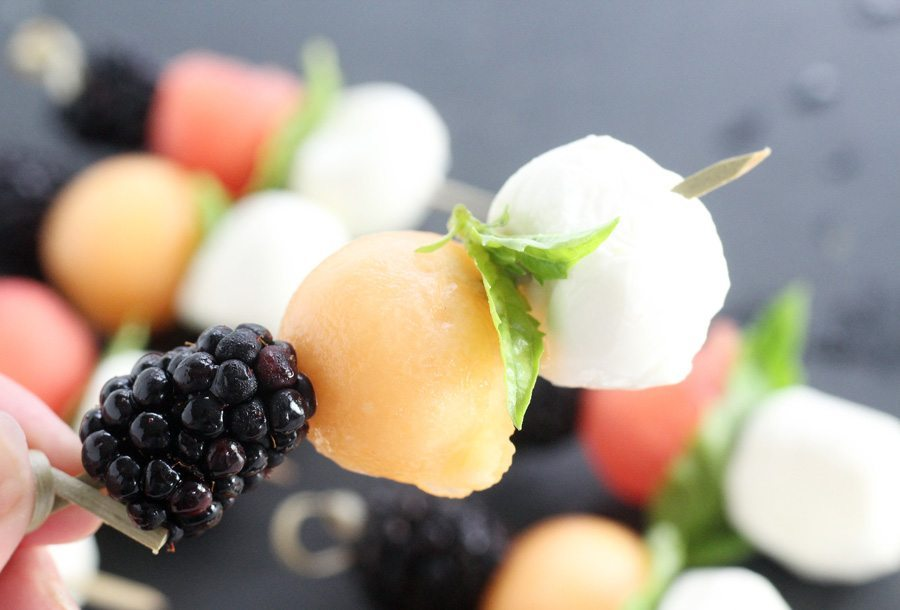 Blackberries, melon and mozzarella on skewers