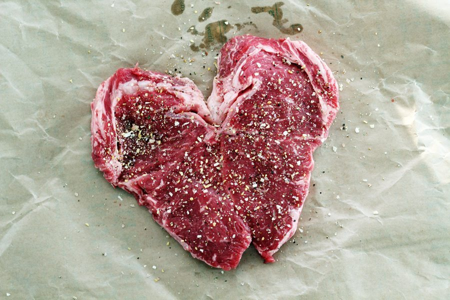 A butterflied heart-shaped ribeye steak on parchment paper