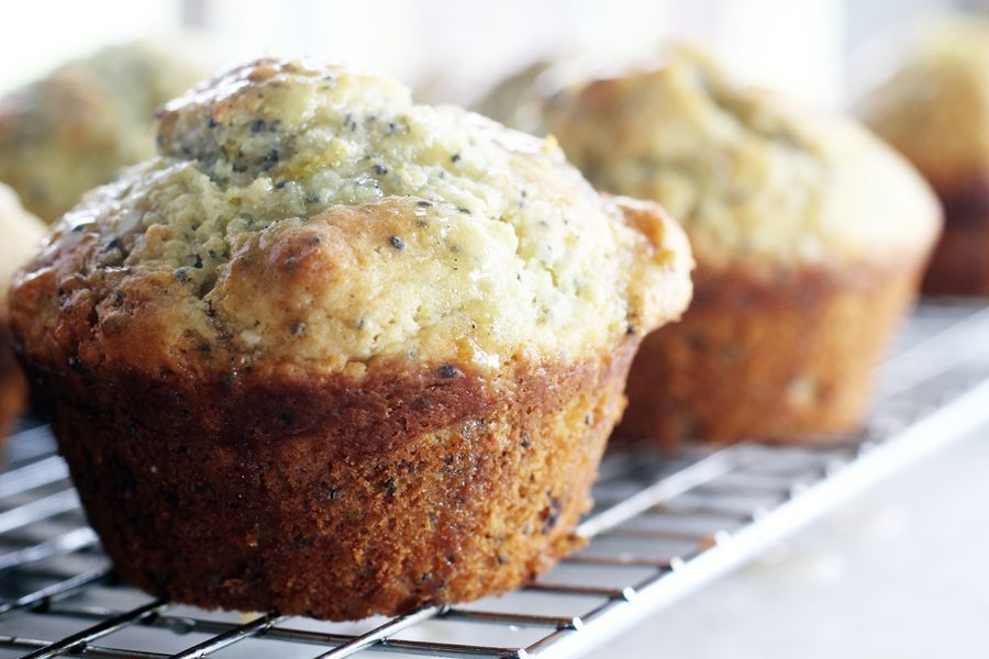 A close up shot of lemon chia seed muffins on a wire cooling rack